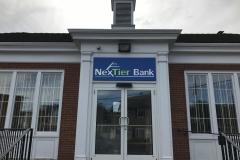 Nextier-Wall-Sign